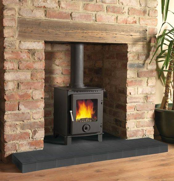 Raised Hearth Fireplace Designs: 20 Ideas To Decorate Around A Wood Burning Stove